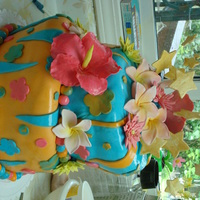 Birthday Cake For My Friend   this is my first try at a topsy turvy cake. gumpaste tropical flowers hibuscus and plumeria turned out pretty good my friend was thrilled