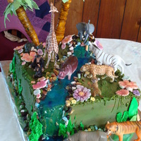 My Daughters Jungle Bday Cake  this for my daughters 7th bday she wanted jungle animals on her cake the cake is scratch chocolate with bavarian creme and iced with...