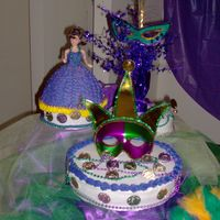 Mardi Gras Theme Sweet Sixteen  I made this cake for a sweet sixteen party. The theme was Mardi Gras. It was buttercream with the mask, beads, and the coins for decoration...