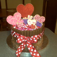 Valentine Cake Chocolate cake, chocolate icing, kit kats, M&M's and almond bark hearts.