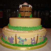 Backyard Baby Shower Theme Backyard theme baby shower cake. Baby bathing in barrel topper, with baby garments on clothes line.