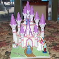 Faiths_Castle_Cake_2.jpg This is a cake I did for my daughters 4th birthday. It's a wilton design.