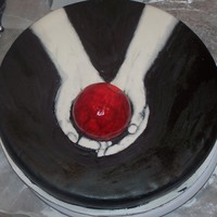 "Twilight Cake This was one of my first cakes I made. I hosted a ""Twilight"" party at my house. The cake is fondant covered, painted black. The..."