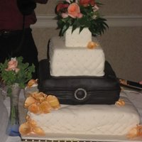 "Brown And Ivory Wedding Cake This was my very first wedding cake and despite a transportation ""mishap"", I'm pretty proud of it. I used Brown and Ivory..."