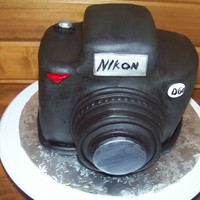 Camera Cake   First attempt. Cake was a little crumbly to carve, next time I wont use chocolate cake!