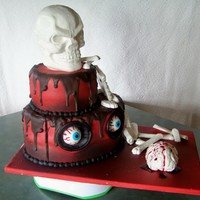 Scary Eyes Skull Cake Solid white chocolate skull. Ganache filled wasc cake.