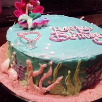 Ariel Ocean Cake This cake was for my little cousin's birthday party. She thinks she IS a mermaid! haha Found a cute ariel figure so I went on that,...