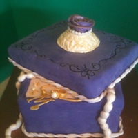 Purple Jewelry Box Birthday Cake  Sculpted jewelry box with gumpaste jewelry for 80th birthday. Bottom of box is constructed of 3 layers of Italian cream cake and the lid is...