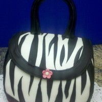 Zebra Purse I made this cake for a coworker. Choc cake with choc fudge filling frosted with BC and covered with MMF. Handle is Gumpaste airbrushed...