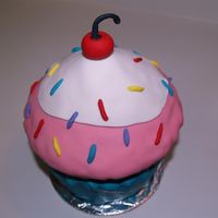 Giant Cupcake Used Wilton pan. All fondant decorations. Copied from idea I saw on CC.
