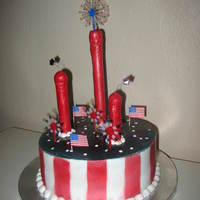 Fireworks Cake For Independence Day First cake for 4th of July. Fireworks theme with red white and blue with stars on top. The blue turned a little darker than I wanted and...