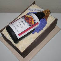Wine Bottle In Box Cake is Marble decorated as a wine box and has a marble cake in the shape of a wine bottle covered in fondant and created label and had a...