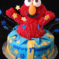 Elmo Cake Elmo cake I made for a friends nephew, inspired by all the elmo surprise cakes made before me. : )thanks for looking