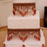 Ivory And Red Beaded The cake is a red velvet with cream cheese filling, the scroll work is fondant , the beads were provided by the bride. Thanks for looking...