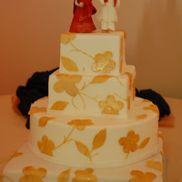 White And Gold the toppers are made from gumpaste, they took forever to make : )thanks for looking