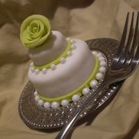 Mini Cake 2-Tier Mini Cake shown with dinner fork for size. Fondant finish and accents. TFL