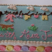 Tickled Pink Yet another clothesline cake! I enjoyed making the fondant buttons and this one definitely turned out better than the last--that's all...