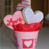 Mini Cookie Boquet This is my first attempt at decorated cookies. They are NFSC with MMF and RI decorations. They were small cookies that I put in a little 2....