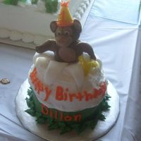 First Birthday Monkey Cake Monkey made from fondant/candy clay mixture. Got the idea from Wilton's 2009 yearbook.