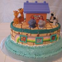 Noah's Ark Shower Cake I purchased the Little People's ark topper and animals online. The cake is baked in oval cake pans so I wouldn't have sculpt it....