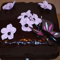 Chocolate Butterfly Cake Chocolate cake with peanut butter filling covered with ganache. Flowers are fondant, butterfly wings are chocolate & body is...