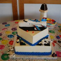 Airplane Cake BC frosting with fondant accents. RKT airplane & control tower.