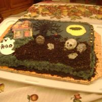 Halloween Cake My grandson gave me the idea for this cake. He wanted a graveyard with the skelton and hands coming out of the grave. The bad thing is I...
