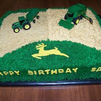 John Deere Inspired by several cakes here on CC. All buttercreme except for tractors (toys) and the letters and deer (fondant).