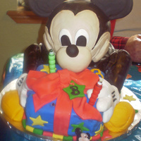 Mickey Mouse Cake With Present mickey mouse cake made with fondant and rice crispies