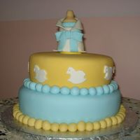 Boy Baby Shower Vanilla cake, buttercream and fondant finish. The topper was made in gumpaste.