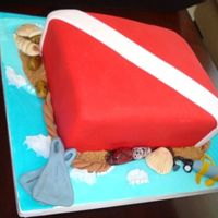 Scuba Diving Flag Simple vanilla cake, rolled fondant, gumpaste decorations and brown sugar sand effect.