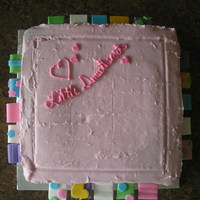 Taggie Cake  I made this cake for the girl next door who is obsessed with her taggies blanket. The cake is iced in buttercream and the tags are made out...