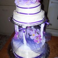 Two Tiered Cake! Made this cake just playing around. One of my first ones. I couldn't even do any flowers at that time so I used silk ones. TFL