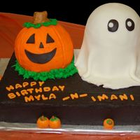 Casper And Friend  Cake ball pumpkin in French Vanilla, Casper is 2 6in and 1/2 ball cake in chocolate w/ a chocolate 11x15. Rhondas Ultimate MMF and True...