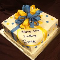 Present Cake  12 in square yellow, bc fill/frost. fondant accents. 1st bow, 1st square pan, 1st plaque/paint technique. need to work on putting my bows...