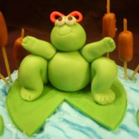 "Girl Frog   This is my first ""model"". My friend LOVES frogs, so i made this for her bday cake! just fondant."