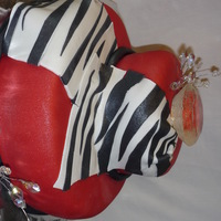 Zebra And Diamond Bachlorette Cake red fondant with zebra drape, the diamond on top is edible, the smaller diamonds are not