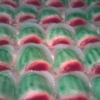 Mini Watermelons These mini watermelons were made for the summer quarterly meeting at my employment. They are Almond Sour Cream cake that was dyed red with...