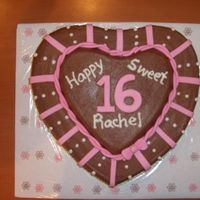 Pink And Brown Sweet 16   Chocolate cake with raspberry preserves. Chocolate buttercream accented with pink MMF and cream buttercream. Very fun to do!