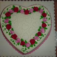 Pink And Red Rosebuds On A Layered Heart   Yellow cake filled with cherry pie filling.