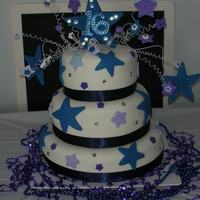 Mackey's Sweet 16 Sweet 16 birthday cake. Rolled fondant icing with satin ribbon. Fun cake to do. Stars on top are wired gum paste with rhinestones applied...