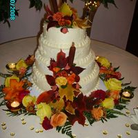 Autumn Wedding Cat tails, acorns, leaves and all but the flowers on the table are gum paste.