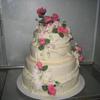 Orchids And Roses July 2009 4 layer cake for wedding - cattelya and dendrobium orchids and small roses and jasmine