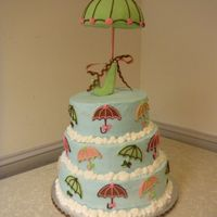 Umbrella Shower Cake This cake was made for a baby shower but would also work as a bridal shower cake. Umbrella was made by covering half a styrofoam ball in...