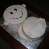 "Baby Cake Too cute! 10"" round head and 9"" round body, iced in buttercream and covered with flesh toned fondant and white fondant diaper...."