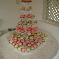 Cupcake Wedding   pink with lime green and pink edible wafer roses