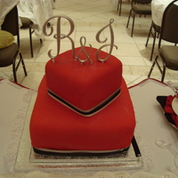 My First Wedding Cake   Couple wanted red black and silver. Those ribbons gave me so much trouble to do anyway it was alright given it was my first wedding cake.