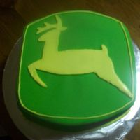 John Deere Cake Chocolate cake w chocolate ganache covered in fondant. I used RI for the deer.