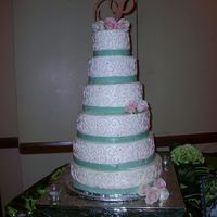 Perez Wedding buttercream cake with fondant ribbon and fresh roses