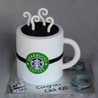 Starbucks For A New Police Officer   bc base icing, fondant handle, steam and logo. Toy badge and cuffs. TFL